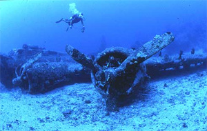 scuba diving wreck with a dive computer